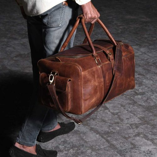 burst-man-walking-with-a-leather-travel-bag